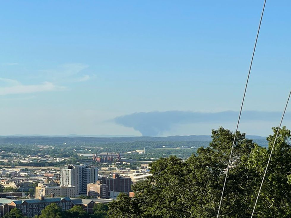 Large black smoke cloud visible from Red Mountain