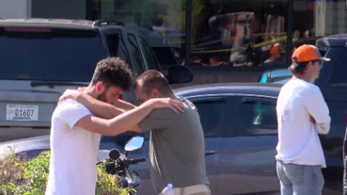 Community members in Collierville comfort each other following deadly mass shooting.