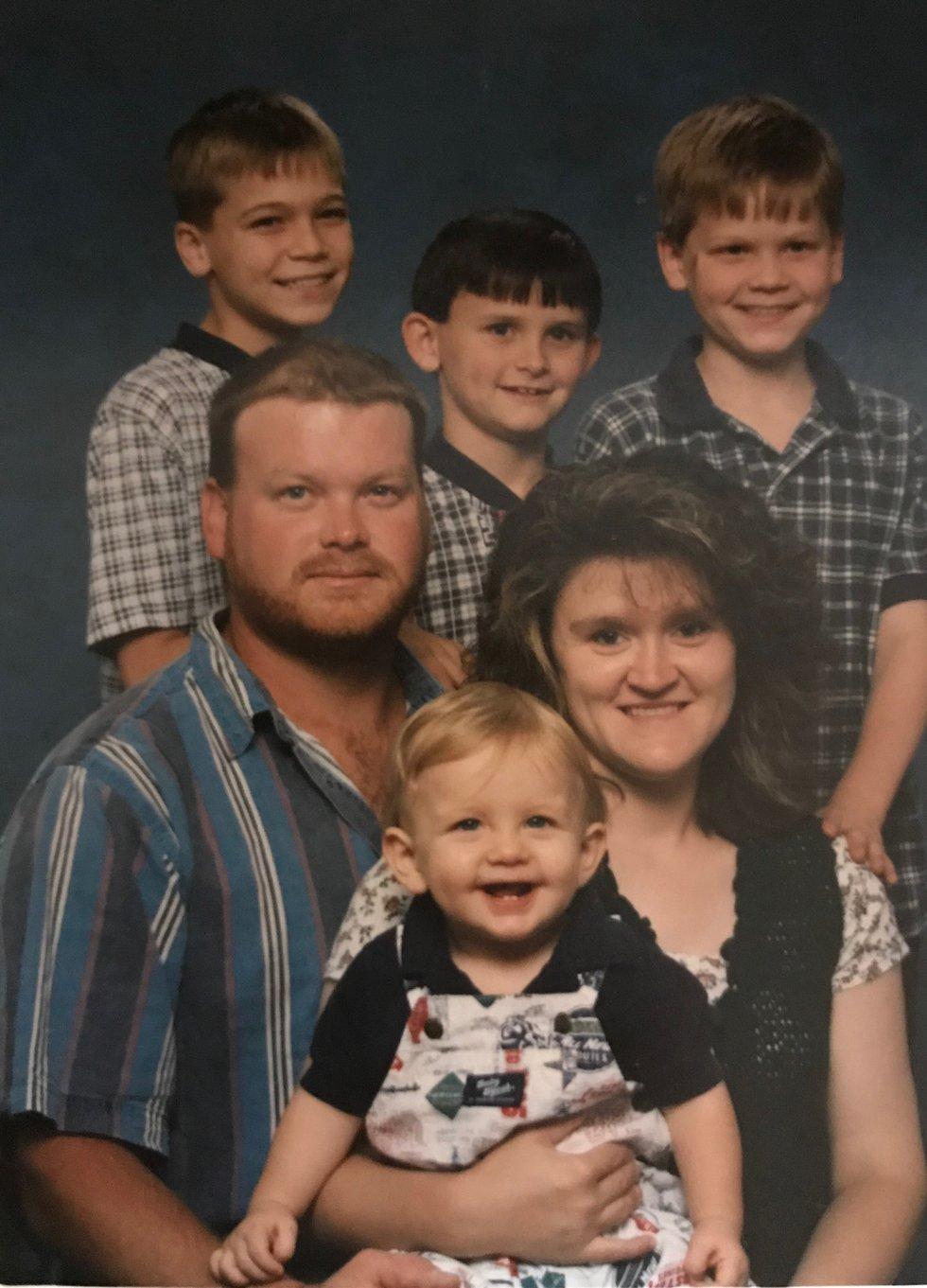 A Holmes family photo. Matt is far right, with his hand on Theresa's shoulder.
