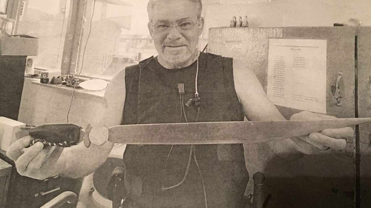 David Ellis holding a sword confiscated from a prisoner at St. Clair Correctional Facility.